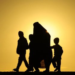 An Afghan family walks during sunset in Herat. Over a third of Afghans are living in abject poverty, as those in power are more concerned about addressing their vested interests rather than the basic needs of the population, a UN report said. (Aref Karimi/Getty Images)